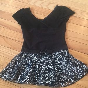 Black leotard with attached skirt
